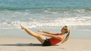 Happy woman working out on beach