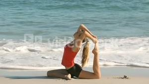 Pretty woman working out on the beach