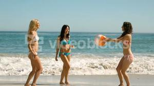 Women playing with a beach ball