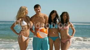Young cheerful people at the beach