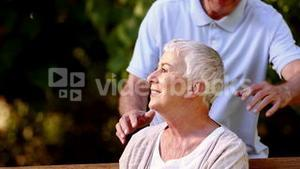 Elderly couple on a park bench