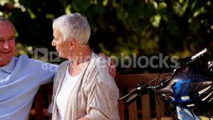 Elderly couple sitting on a bench park
