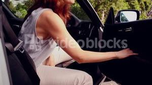 Woman getting out of her convertible car