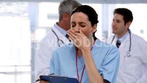 Tired nurse with clipboard