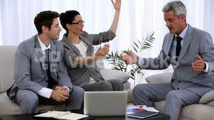 Group of business people gesturing during a meeting