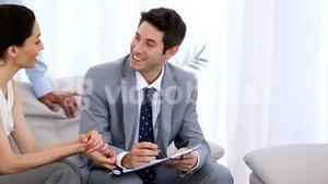 Couple discussing with a salesman