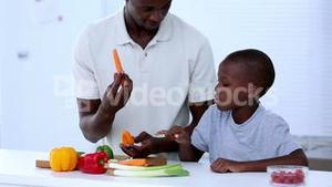 Father and his son choosing vegetables