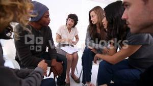 Patients of group therapy talking