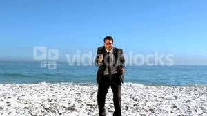 Free businessman dancing on the beach