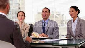 Business people laughing during a job interview