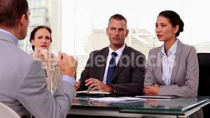 Business people listening to a job applicant