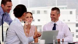 Cheerful business people working together in their office