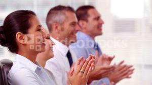 Cheerful business people applauding