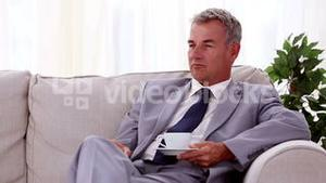 Smiling businessman drinking a cup of tea
