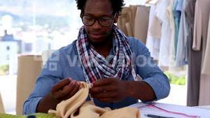 Fashion designer working with a fabric