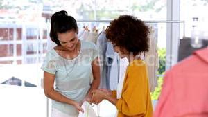 Woman looking at the purchases of a friend