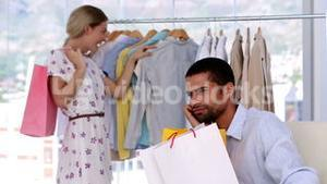 Man being annoyed by his girlfriend