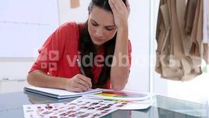 Photo editors drawing on a notepad