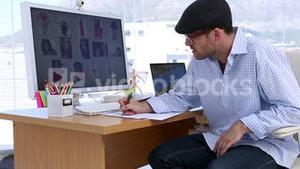 Photo editor writing on a paper