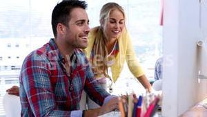 Attractive designers working on a computer
