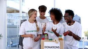 Volunteers watching the food in donation box