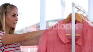 Woman doing shopping in clothes shop