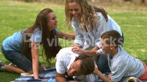 Happy family playing together in a park
