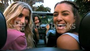 Friends laughing in the car