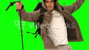 Man with a hiking stick running on green screen