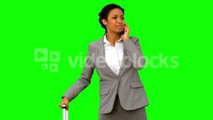 Late woman throwing her phone on green screen