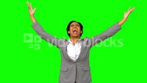 Angry businesswoman raising arms on green screen