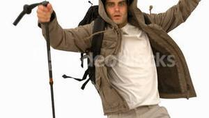 Man with a hiking stick running on white screen