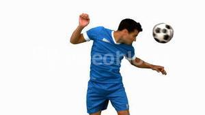Man heading a football on white screen