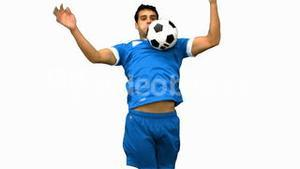 Handsome man controlling a football with his chest on white screen