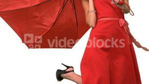 Woman in high heels holding a broken umbrella on white screen