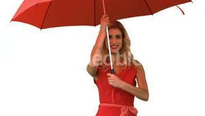 Woman holding an umbrella on white screen
