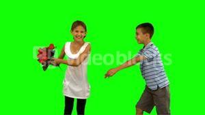 Boy offering a bouquet of flowers to a little girl on green screen