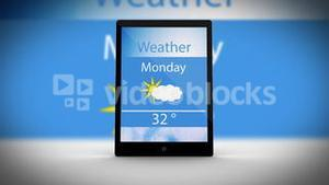Tablet computer showing news and weather