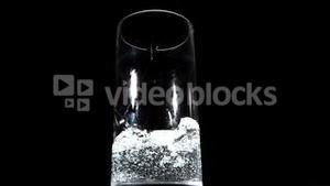 Water being poured on black background