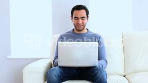 Man using a laptop on the couch