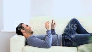 Man using a tablet on the couch