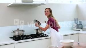 Blonde woman preparing meal in kitchen