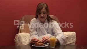 Stock Footage of a Woman Eating Breakfast