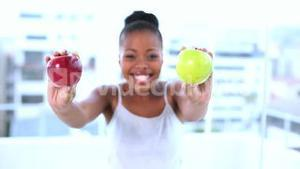 Cheerful natural model holding apples