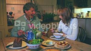 Mature couple having dinner together