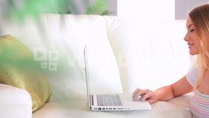 Charming blonde having a conversation on her laptop