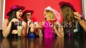 Dressed up friends having hen party