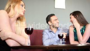 Single woman being envious at happy couple