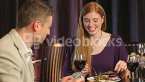 Attractive couple dining together
