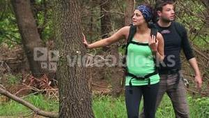 Fit couple exploring a wooded area